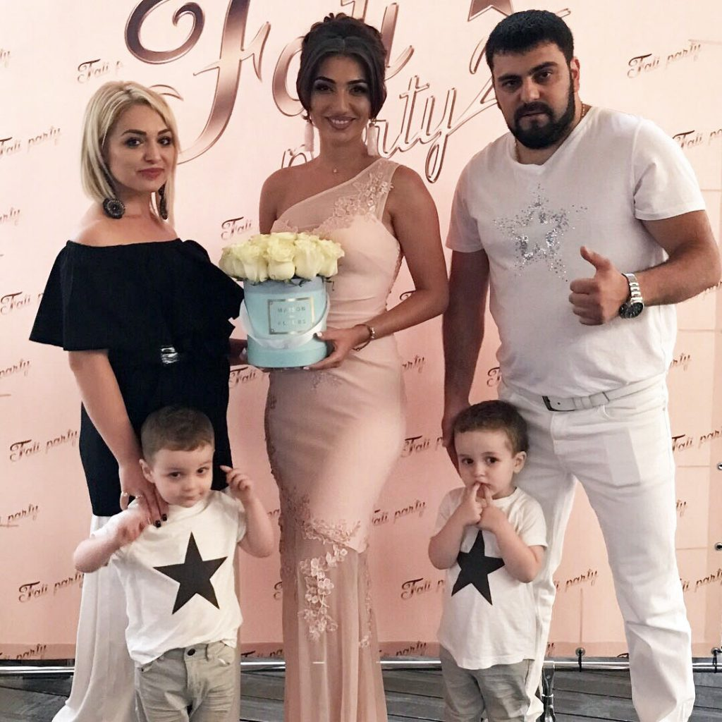 Arthur and Alina Khalatovy with their sons and Fati Tsarikayeva at the celebration of the singer's 25 anniversary