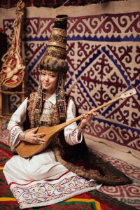 Girl with dombra. Kazakhstan. Photo courtesy of http://fadn.gov.ru