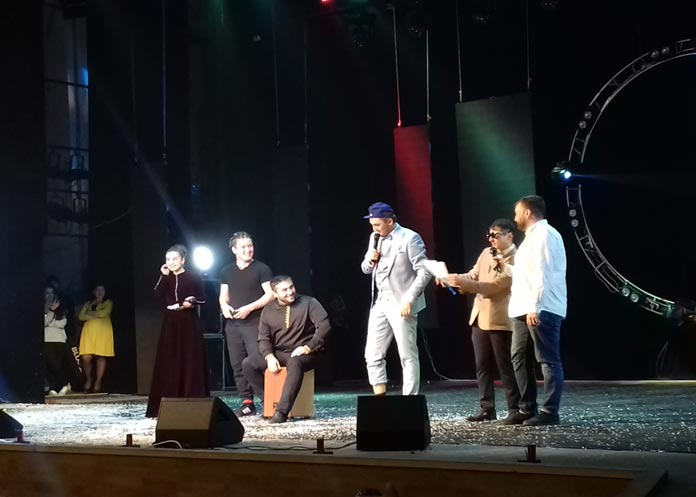 """Akhmat Teppeev and Slavik Thamitlokov with an improvised rap group perform the author's song """"Zhanikayev Eldar"""""""